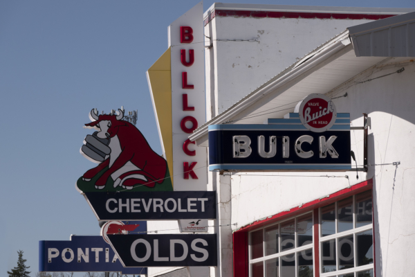 Old auto dealer signs. LP Photo Video. Omaha Photography.