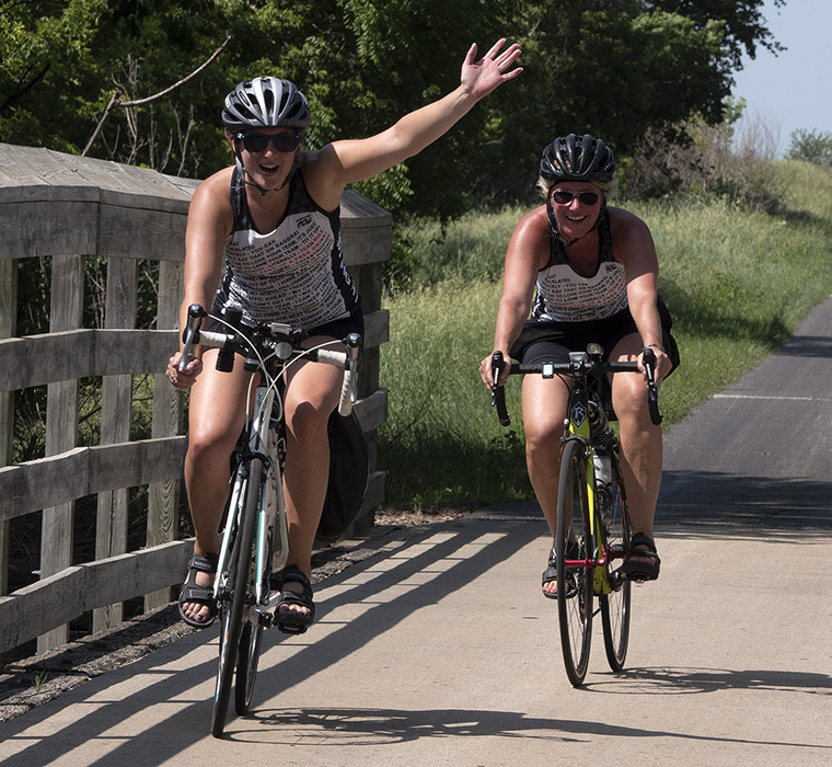 Bicycle riding on the Raccoon River Valley Trail in Iowa. LP Photo Video. Omaha Photography.